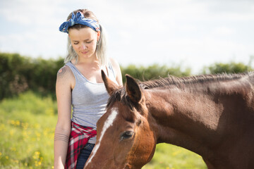 Young lady feeding her horse