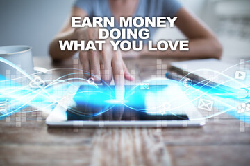 Woman using tablet pc, pressing on virtual screen and selecting earn money doing what you love.