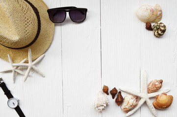 Summer hat and sunglasses with accessories  on white background