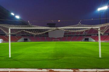 Soccer goal football on the green field inside the stadium