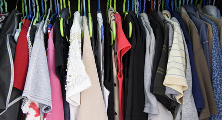 Clothes in wordrobe.