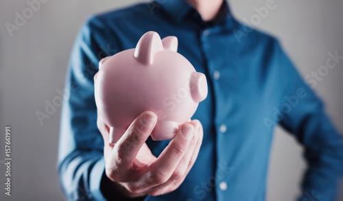 male hand holding a piggy bank stockfotos und. Black Bedroom Furniture Sets. Home Design Ideas