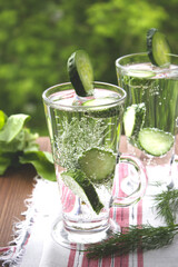Cold drinking water with cucumber and dill in a glass