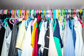 messy clothes in closet