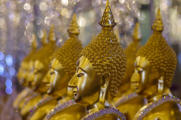 UTHAI THANI PROVINCE, THAILAND - August, 2016: Golden Buddha statue at Cathedral glass, Wat Tha Sung or Wat Chantharam