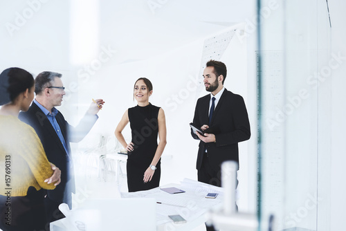 Male And Female Managers Of Marketing Corporation Dressed In Formal