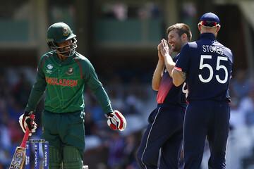 England's Mark Wood with Bangladesh's Tamim Iqbal