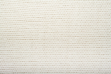 Pattern of the White Knitted Fabric Texture. Woolen background.
