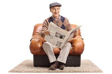 Joyful mature man with newspaper sitting in leather armchair