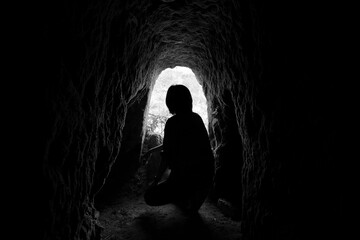 Silhouette of tourist in old mining tunnel