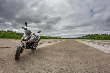 The motorcycle is on the road