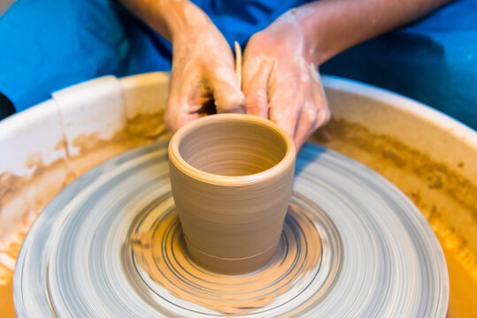 Pottering - creating a clay cup in process