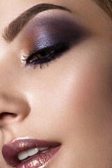 Beautiful girl with perfect skin, colorful make-up .Beauty face. Picture taken in the studio. Close up