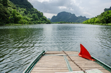 Boat for tourist travel around trang an Vietnam world heritage with mountain, river and sky.