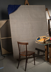 Chair and canvas in the artist's studio