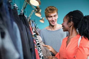 Young couple shopping in cool clothes shop