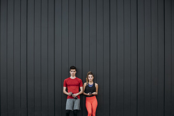 Portrait of man and woman wearing sports clothing