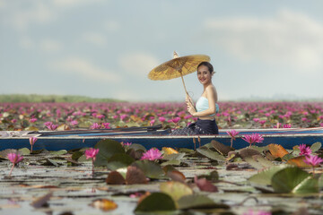 Laos woman in flower lotus lake, Woman wearing traditional