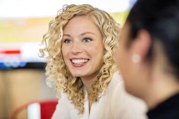 Blond businesswoman listening to presentation