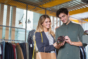 Young couple shoping for shoes