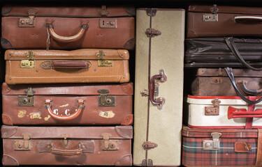 Multiple vintage suitcases