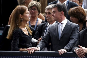 French Prime Minister Manuel Valls and his wife Anne Gravoin attend the men's singles semi-finals at the Paris Masters tennis tournament at the Bercy sports hall in Paris