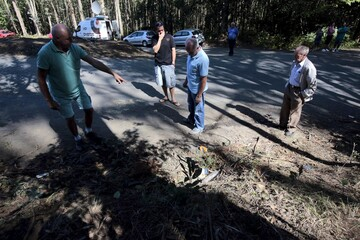 Onlookers view the wreckage of a rally crash in Carral, northwestern Spain