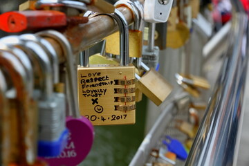 """Love, Respect, Friendship, Loyalty, Trust"" Lots of Padlocks on a Bridge"