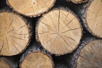 Photo sur Aluminium Texture de bois de chauffage Firewood for the fireplace, barbecue. A man chopping wood for a barbecue. Folded firewood