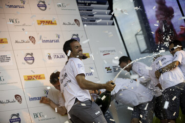 Skipper Franck Cammas from France sprays a magnum of champagne. Groupama Sailing Team celebrate winning the DHL In-Port Race Itajai, Brazil, in the Volvo Ocean Race 2011-12, Brazil on Saturday, Apr. 21, 2012 (Credit: Paul Todd/Volvo Ocean Race photo via Ac