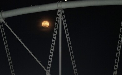 The moon as seen through the roof of the Engenhao Olympic Stadium in Rio de Janeiro
