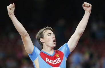Shubenkov of Russia reacts after winning the men's 110m hurdles during the 15th IAAF World Championships at the National Stadium in Beijing