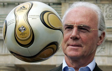 Franz Beckenbauer, President of Germany's World Cup organising committee, plays with a golden soccer ball