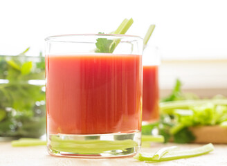 Two glasses of tomato juice.