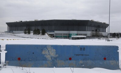 File photo of a 'no trespassing' barricade blocking an entrance to the parking lot of the vacant Pontiac Silverdome, former home of the Detroit Lions NFL team, in Pontiac, Michigan