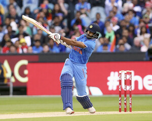 India's Shikhar Dhawan hits a six while batting against Australia during their T20 cricket match at the Melbourne Cricket Ground