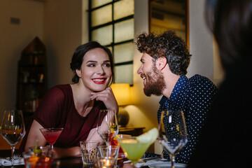 Young couple enjoying drinks