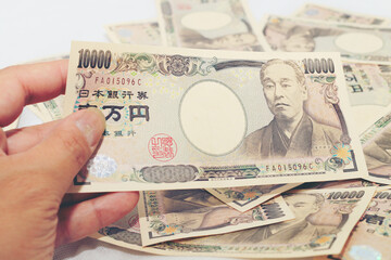 Hand counting money, Japanese currency note , Japanese yen on white background.