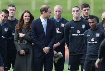 The Duke and Duchess of Cambridge, Prince William (C) and Kate Middleton (3rd L) with England's Phil Jagielka (L), Gary Cahill (2nd L), John Ruddy, Andy Carroll, Ashley Cole (R) and team mates during the launch of the Football Association's National Football Centre