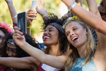 Woman taking selfie on mobile phone