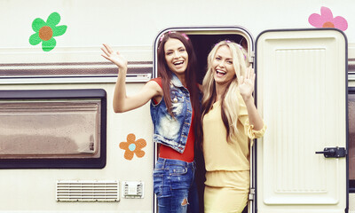 Happy hippie friends are having a good time together in camper trailer. Holiday, vacation, trip concept.