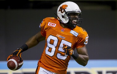 B.C Lions' Shawn Gore celebrates his touchdown against the Hamilton Tiger-Cats during the first half of their CFL football game in Vancouver
