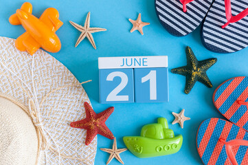 June 21st. Image of june 21 calendar on blue background with summer beach, traveler outfit and accessories. Summer day