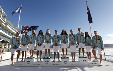 Athletes from Australia's Olympic team going to the 2016 Olympics in Rio present their uniforms at an official unveiling ceremony at Sydney's Bondi Beach