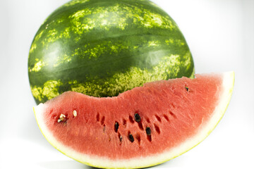 Beautifully cut watermelon slice. Watermelon on white background. Beautiful ripe watermelon close-up.