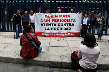 Colleges of journalist Salvador Adame Pardo stand with a banner during a protest against the May 18 disappearance of Adame, outside the offices of the Attorney General of the Republic in Mexico City