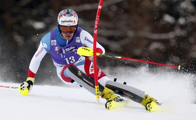 Yule of Switzerland clears a gate during the first run in the men's slalom at the Alpine Skiing World Cup in Santa Caterina Valfurva
