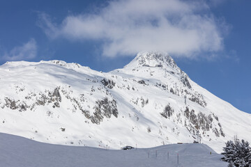 Blue sky frames the snowy peak and ski slopes on a sunny day Bettmeralp district of Raron canton of Valais Switzerland Europe