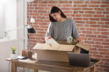 Fired Business Woman Packing Her Belongings