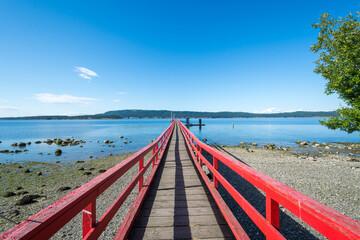 Red ocean pier on Salt Spring Island, BC, Canada.